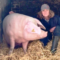 Camilla Mitchell and pig enjoying back stratch